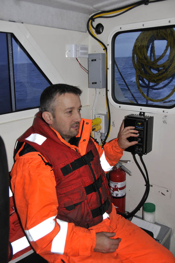 Moore at the controls of the side-scan sonar cable winch in the Kinglett.