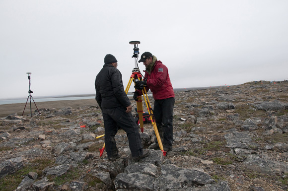 Mervin Joe and Henry Cary setting up the survey-grade GPS unit at the Paleoeskimo site