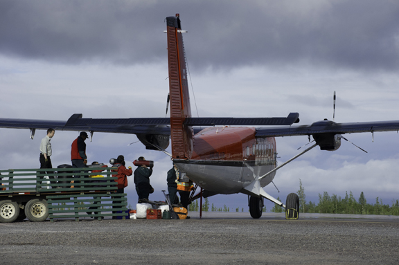 Loading of a second twin otter plane with diving gear.