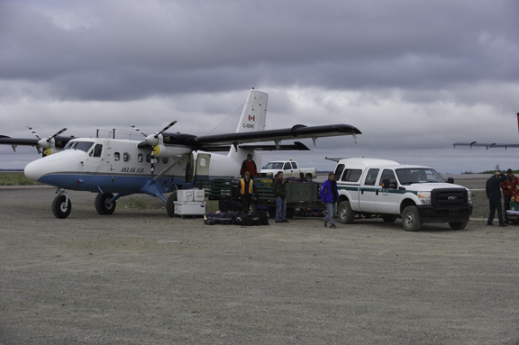 Loading one of the Twin Otter planes with camping gear prior to departure.