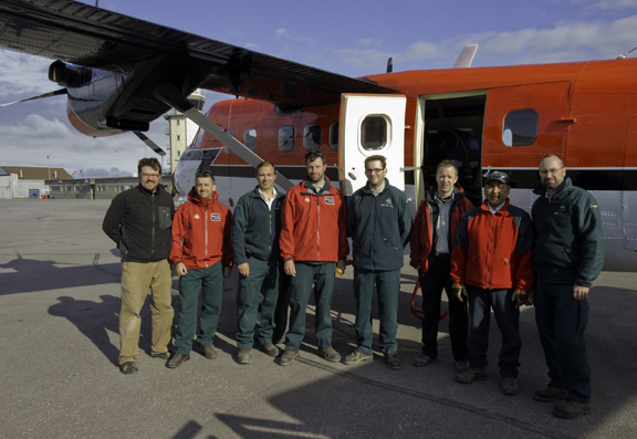 Team: Part o f the team before the departure on Saturday July 9th of two of the four plane trips needed to bring all the necessary equipment and team members from Inuvik to Mercy Bay.  From left to right: Brett Seymour, Jonathan Moore, Filippo Ronca, Thierry Boyer, Ryan Harris, Henry Cary, Mervin Joe and Marc-André Bernier.