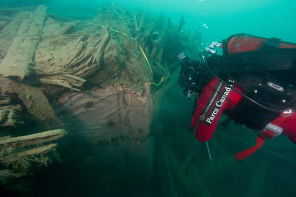 Archaeologist at the stern of HMS Investigator.