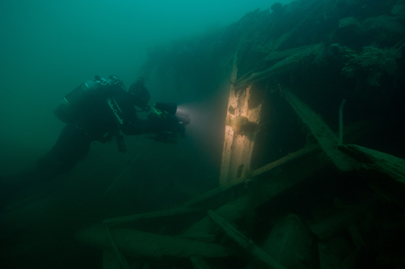 Diver filming the stern post of HMS Investigator.