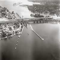 Aerial view of the Sainte-Anne-de-Bellevue  	  Historic Canal (1975) In the background, the dredged channel protected by earth levees  		and the Becker Dam.