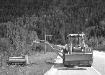 Clearing sidelines along the Trans-Canada Highway to reduce vehicle-animal collisions.