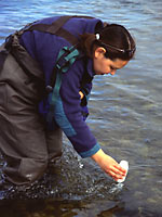 Mary Anne Francey taking water samples from the Thompson River