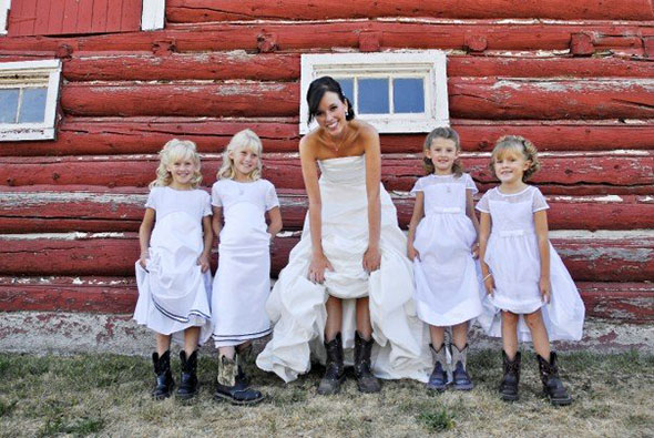 Bride and flower girls show off their cowgirl boots