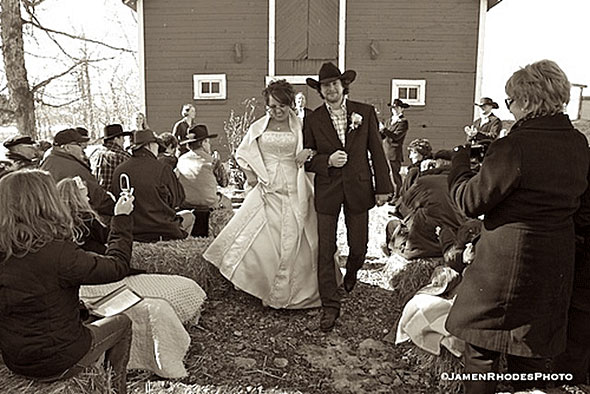 Bride and groom by the dairy barn