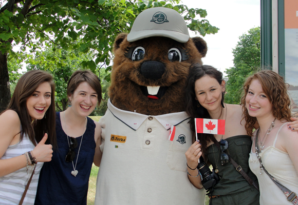 Parka poses with a group of young women at The Forks National Historic Site.