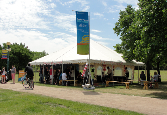 A view of The Forks National Historic Site / Parks Canada tent set up during Canada Day.