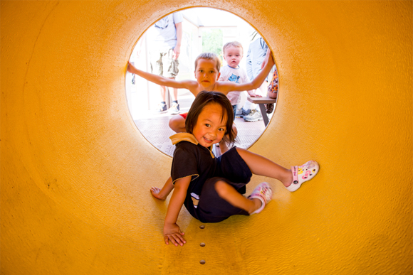 Children playing in the tunnel area of the train engine