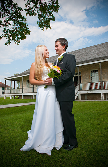<br />Bride and groom in front of the Big House