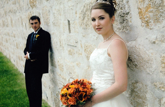 Bride and groom along Fort walls