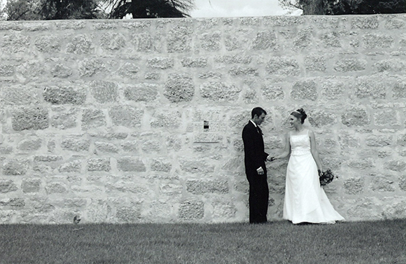 Bride and groom outside Fort walls