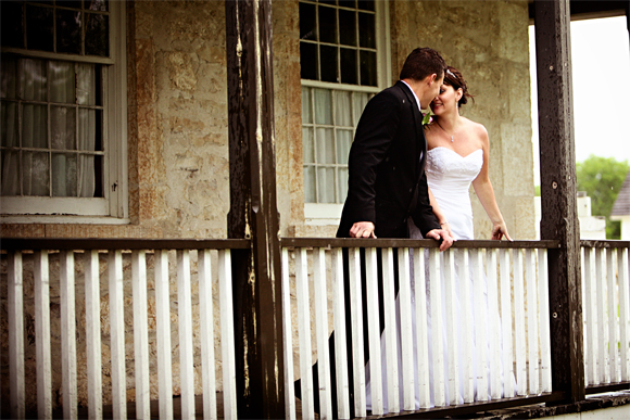 Bride and groom on the verandah of the Big House