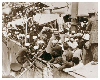 Would-be Canadians aboard a ship preparing to depart for