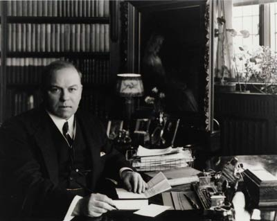 King sitting in his study, 1932.