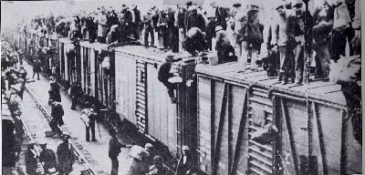 Rioters atop railroad cars, others climbing, police and others below.