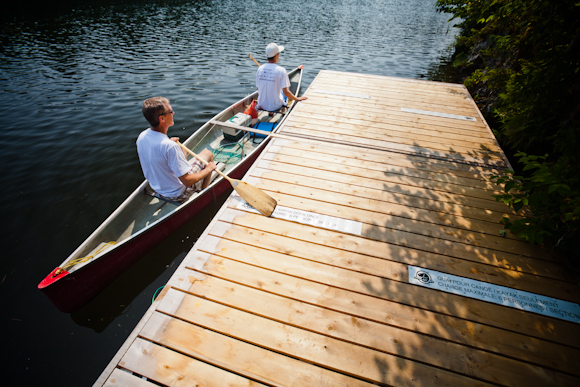Paddlers at a Rideau Canal paddling dock