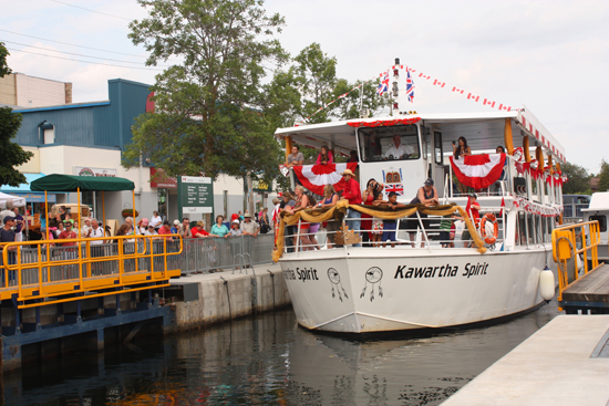 The Kawartha Spirit leaves Lock 34 in Fenelon Falls, fully decorated to celebrate Queen Elizabeth's Diamond Jubilee.