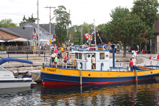 Parks Canada staff show visitors around the Tug Trent, a 45 foot tug boat built in 1948.
