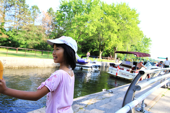 One of the young campers watches as boats load into Lock 20 Ashburnham.