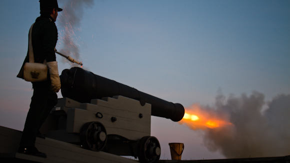 During a rare evening cannon firing demonstration, flames jetted from the end of an original 1812 era 24 pounder cannon, a weapon that can lob cannon balls across the border into Ogdensburg, NY.
