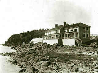 ancient picture of the second-class hotel, built on rock, on the shore of the St.Lawrence river