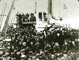 a large group of immigrants on the deck of a boat