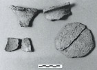 These Aboriginal pottery fragments were found in the vicinity of the disinfection building, and are from a vase which is typical of the traditional ceramics produced by the St. Lawrence Iroquois. This vase probably dates to the period between the early 13th century and the late 16th century.
