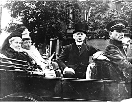 Black and white pictures of Laurier, his chauffeur, and his friends in a car.