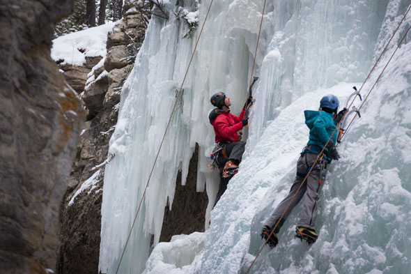 Ice walkers can comfortably watch as Ice Climbers take to the canyon's spectacular falls