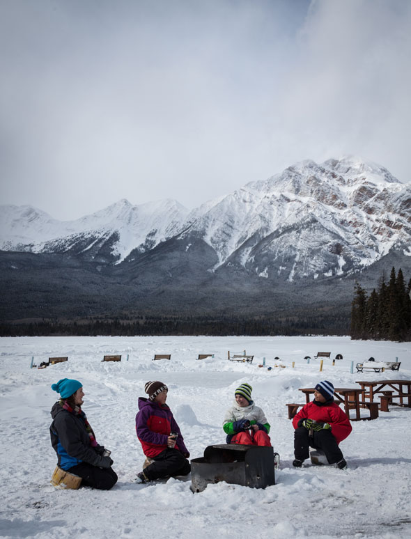 Warming around the fire – a natural way to wind down a great winter's day in Jasper!