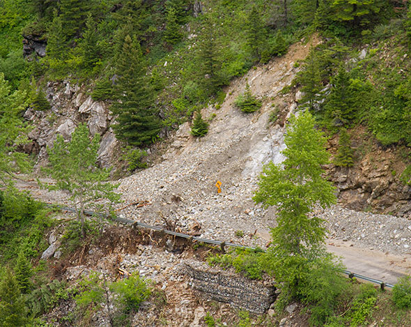 Debris and retaining wall washout, Site 5