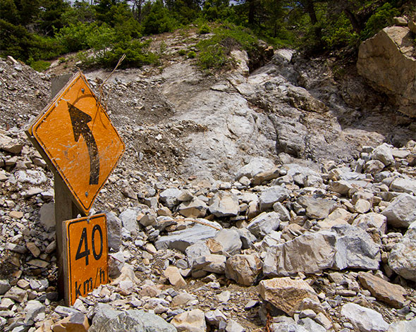 Sign buried in flood debris, Site 5