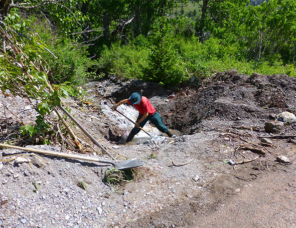 Clearing a culvert by hand