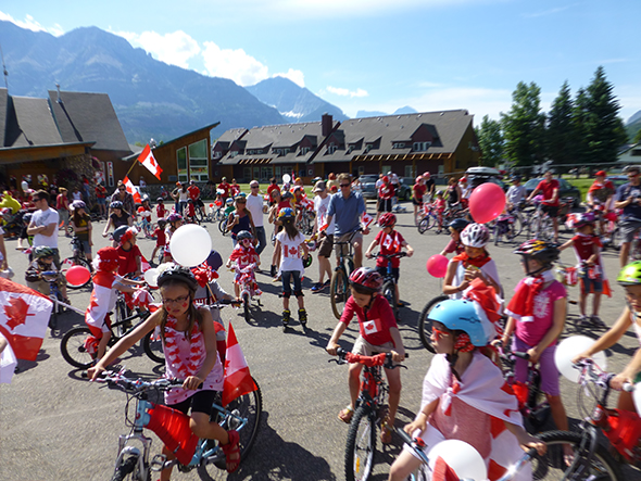 Waterton is a sea of red and white as the Canada Day parade gets underway