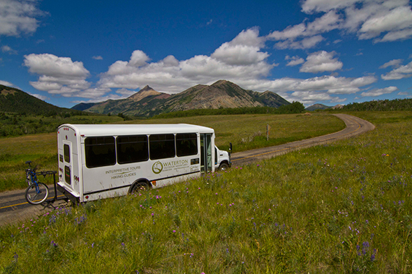 A shuttle bus makes its way along the Red Rock Parkway. Parks Canada offered the service to alleviate traffic problems after the June floods