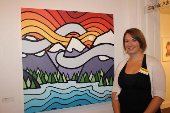 Leanne Spanza beside 'Clouds Hugging Mountains'
