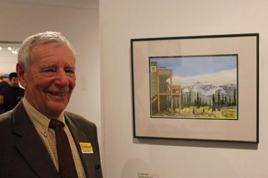 Artist James Webb with one of his paintings