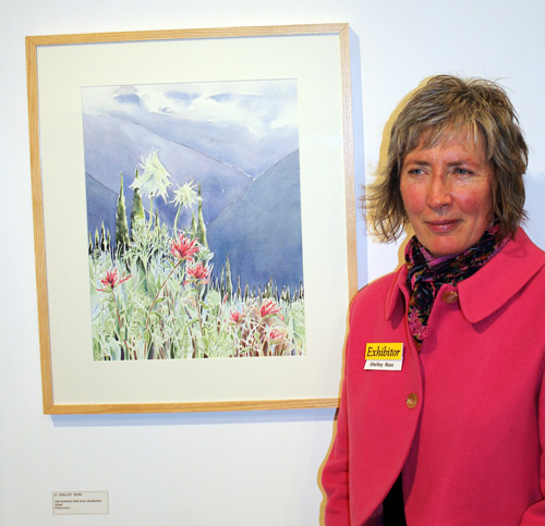 Artist Shelley Ross with one of her paintings