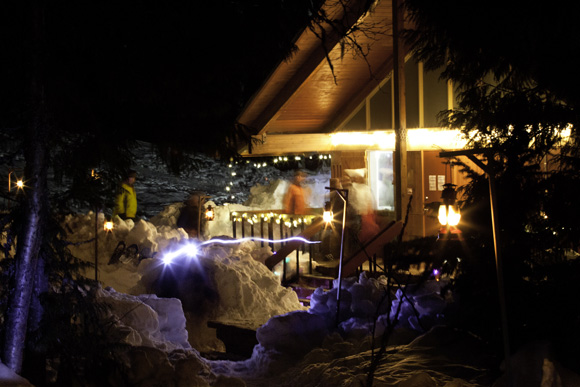 The Nels Nelsen Chalet covered in lights and lanterns