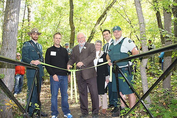 Mr. Robert Sopuck, Member of Parliament for Dauphin-Swan River-Marquette, officially opens Reeve's Ravine Trail.