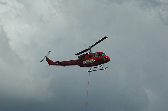 Helicopters are used to bucket the fire with water