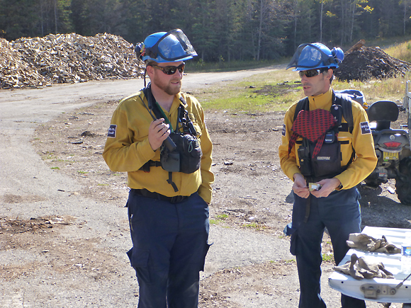 Two members of the fire crew prepare for a day on the fire line