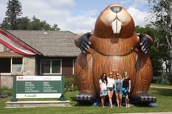 Visitors from Winnipeg getting their picture taken with the Big Inflatable Beaver.