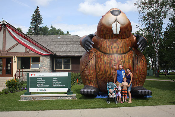 Family from Saskatchewan posing in front of the Big Inflatable Beaver visiting Riding Mountain National Park this week