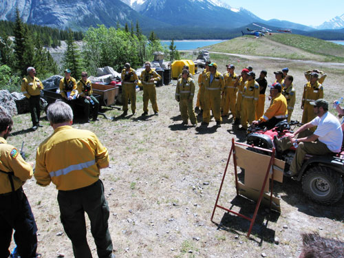 Fire crews receive important safety and operational information every morning prior to fire operations © Parks Canada 2008