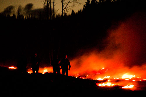 Night guard burning within the fuel break at the Ya Ha Tinda Ranch © Parks Canada 2009