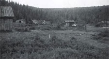 Log cabins in Newman Sound, circa 1930